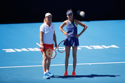 Martina Navratilova (L) of the United States and Daniela Hantuchova of Slovakia talk tactics in their women's doubles match against Alicia Molik of Australia and Barbara Schett of Austria on day nine of the 2018 Australian Open at Melbourne Park on January 23, 2018 in Melbourne, Australia.