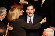Rep. Ileana Ros-Lehtinen (R-FL) (L) embraces Sen. Marco Rubio (R-FL) before Australian Prime Minister Julia Gillard addresses a joint meeting of the U.S. Congress from the floor of the House of Representatives at the U.S. Capitol March 9, 2011 in Washington, DC. Gillard emphasized the long and strong bond between her country and the United States.