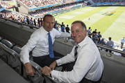 New Zealand Prime Minister John Key (R) and Australian Prime Minister Tony Abbott at Eden Park pose for a photo during the New Zealand - Australia Cricket World Cup Pool A match on February 28, 2015 in Auckland, New Zealand. Toda marks Abbott's first official visit to New Zealand as Prime Minister.