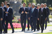Luxembourg Prime Minister Xavier Bettel (C), Portuguese Prime Minister Antonio Costa (R from Bettel), French President Emmanuel Macron, British Prime Minister Theresa May and other leaders arrive for family photo on the second day of an informal summit of leaders of the European Union on September 20, 2018 in Salzburg, Austria. High on the agenda of the two-day summit is migration policy.