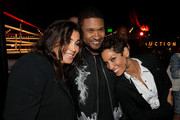 (L-R) Bernadette Leonard, recording artist Usher and television personality Nicole Murphy attend the B. Riley & Co. and Sugar Ray Leonard Foundation's 5th Annual 'Big Fighters, Big Cause' Charity Boxing Night at the Santa Monica Pier on May 20, 2014 in Santa Monica, California.