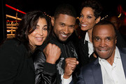 (L-R) Bernadette Leonard, recording artist Usher, television personality Nicole Murphy and Former professional boxer Sugar Ray Leonard attend the B. Riley & Co. and Sugar Ray Leonard Foundation's 5th Annual 'Big Fighters, Big Cause' Charity Boxing Night at the Santa Monica Pier on May 20, 2014 in Santa Monica, California.