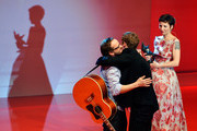 Matthias Schweighoefer (C) receives the B.Z. Kulturpreis from his friend and laudator Milan Peschel (L) while Meret Becker (R) stands by on January 18, 2013 in Berlin, Germany.