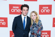 """Josh O'Connor and Ellie Bamber attend a photocall for BBC One's """"Les Miserables"""" at BAFTA on December 05, 2018 in London, England."""