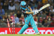 Alex Ross of the Heat is bowled by  Dwayne Bravo of the Renegades during the Big Bash League match between the Melbourne Renegades and the Brisbane Heat at Etihad Stadium on December 23, 2017 in Melbourne, Australia.