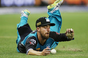 Alex Ross of the Heat saves a boundary when fielding during the Big Bash League match between the Melbourne Renegades and the Brisbane Heat at Etihad Stadium on December 23, 2017 in Melbourne, Australia.