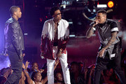(L-R) Singers Trey Songz, August Alsina and Chris Brown perform onstage during the BET AWARDS '14 at Nokia Theatre L.A. LIVE on June 29, 2014 in Los Angeles, California.