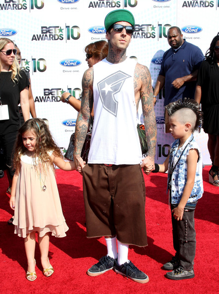 Musician Travis Barker (C) and family arrive at the 2010 BET Awards held at the Shrine Auditorium on June 27, 2010 in Los Angeles, California.