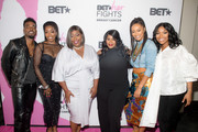 (L-R) Luke James, Estelle, Loni Love, Kelly Price, Keri Hilson, and Brandy pose backstage during the 'BET Her Fights Breast Cancer' special event at Riverside Epicenter on September 20, 2018 in Atlanta, Georgia.