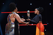Lizzo accepts Entertainer of the Year award from Janelle Monae onstage during the 51st NAACP Image Awards, Presented by BET, at Pasadena Civic Auditorium on February 22, 2020 in Pasadena, California.