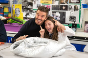 David Beckham jokes with a pupil as the BFC launch fashion studio apprenticeship with ambassadorial president, David Beckham,  ambassador for positive fashion, Adwoa Aboah and designers Richard Quinn, Rosh Mahtani and Paolino Russo at Prendergast Vale School on September 23, 2019 in London, England.