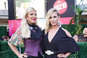 (L-R) Tori Spelling and Jennie Garth attend the Beverly Hills 90210 Costume Exhibit Event at The Atrium at Westfield Century City on August 19, 2019 in Los Angeles, California.
