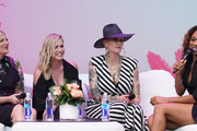 (L-R) Tori Spelling, Jennie Garth, Mandi Line and Nischelle Turner participate in the Beverly Hills 90210 Costume Exhibit Event at The Atrium at Westfield Century City on August 19, 2019 in Los Angeles, California.