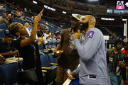 Carlos Boozer #5 of the Ghost Ballers takes a photo with fans during week eight of the BIG3 three on three basketball league at Infinite Energy Arena on August 10, 2018 in Duluth, Georgia.
