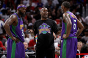 Head coach Gary Payton of the 3 Headed Monsters meets with Reggie Evans #30 and Qyntel Woods #6 during the game against Tri-State during BIG3 - Week Four at Little Caesars Arena on July 13, 2018 in Detroit, Michigan.