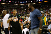 Allen Iverson (L) of 3's Company laughs with Kam Chancellor of the Seattle Seahawks while attending week nine of the BIG3 three-on-three basketball league at KeyArena on August 20, 2017 in Seattle, Washington.