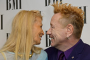 (L-R) Nora Forster and John Lydon attends the BMI Awards at The Dorchester on October 15, 2013 in London, England.