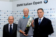 Fredrik Andersson Hed of Sweden is presented with the winner's trophy by Franco Chimenti, president of the Italian Golf Federation (L) and Gianni Oliosi, BMW Italy after the final round of the BMW Italian Open at Royal Park I Roveri on May 9, 2010 in Turin, Italy.