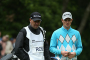 Justin Rose of England looks on with his caddie Mark Fulcher during day two of the BMW PGA Championship at Wentworth on May 23, 2014 in Virginia Water, England.