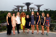 (L-R) Caroline Wozniacki of Denmark, Agnieszka Radwanska of Poland, Petra Kvitova of Czech Republic, Serena Williams of USA, Stacey Allaster Chairman and CEO of the WTA, Maria Sharapova of Russia, Ana Ivanovic of Serbia, Eugenie Bouchard of Canada and Simona Halep of Romania pose for a photo at the Gardens by the Bay during previews for the WTA Finals at Singapore Sports Hub on October 18, 2014 in Singapore.