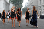 Angelique Kerber of Germany, Flavia Pennetta of Italy, Garbine Muguruza of Spain, Petra Kvitova of Czech Republic, Agnieszka Radwanska of Poland, Simona Halep of Romania and Lucie Safarova of Czech Republic attend the official photo shoot for the BNP Paribas WTA Finals at the Old Supreme Court Building on October 23, 2015 in Singapore.