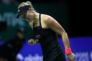 Angelique Kerber of Germany celebrates winning the first set in her singles match against Kiki Bertens of the Netherlands during day 2 of the BNP Paribas WTA Finals Singapore presented by SC Global at Singapore Sports Hub on October 22, 2018 in Singapore.