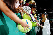Angelique Kerber of Germany signs autographs for fans after her women's singles match against Naomi Osaka of Japan during day 4 of the BNP Paribas WTA Finals Singapore presented by SC Global at Singapore Sports Hub on October 24, 2018 in Singapore. at Singapore Sports Hub on October 24, 2018 in Singapore.