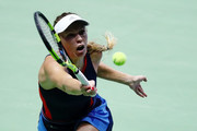 Caroline Wozniacki of Denmark plays a forehand in her singles match against Elina Svitolina of the Ukraine during day 5 of the BNP Paribas WTA Finals Singapore presented by SC Global at Singapore Sports Hub on October 25, 2018 in Singapore.
