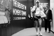 Image has been converted to black and white.) Caroline Wozniacki of Denmark reacts to walks onto the court prior to her singles match  with Petra Kvitova of the Czech Republic prior to their singles match during day 3 of the BNP Paribas WTA Finals Singapore presented by SC Global at Singapore Sports Hub on October 23, 2018 in Singapore.  at Singapore Sports Hub on October 23, 2018 in Singapore.