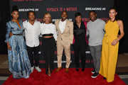 "(L-R) Gabrielle Union, Devonta Freeman, Heather Hayslett Packer, Will Packer, Keisha Lance Bottoms, James Lopez, and Jaime Primak Sullivan attend ""Breaking In"" Atlanta Private Screening at Regal Atlantic Station on April 22, 2018 in Atlanta, Georgia."