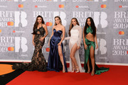 (L-R) Jesy Nelson, Perrie Edwards, Jade Thirlwall and Leigh-Anne Pinnock of the band Little Mix attend The BRIT Awards 2019 held at The O2 Arena on February 20, 2019 in London, England.