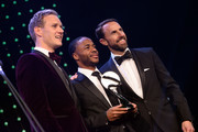 Gareth Southgate, Manager of England (R) and Dan Walker (L) pose for a photo with The Integrity and Impact Award founded by Dow Jones Intelligence winner, Raheem Sterling (C) at the BT Sport Industry Awards 2019 at Battersea Evolution on April 25, 2019 in London, England. The BT Sport Industry Awards is the biggest commercial sports awards in the world and an annual showcase of the best of the sector's creative and commercial output. The event brings together sports stars, celebrities, industry leaders, influencers and media from around the world for what is always a highly anticipated occasion.