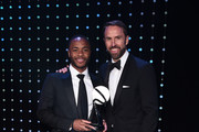 Gareth Southgate, Manager of England (R) presents The Integrity and Impact Award founded by Dow Jones Intelligence to Raheem Sterling during the BT Sport Industry Awards 2019 at Battersea Evolution on April 25, 2019 in London, England. The BT Sport Industry Awards is the biggest commercial sports awards in the world and an annual showcase of the best of the sector's creative and commercial output. The event brings together sports stars, celebrities, industry leaders, influencers and media from around the world for what is always a highly anticipated occasion.