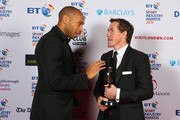 Thierry Henry talks to AP McCoy, winner of the Outstanding Contribution to Sport, sponsored by CWM Cyclong Promotions at the BT Sport Industry Awards 2015 at Battersea Evolution on April 30, 2015 in London, England. The BT Sport Industry Awards is the most prestigious commercial sports awards ceremony in Europe, where over 1750 of the industryÂ's key decision-makers mix with high profile sporting celebrities for the most important networking occasion in the sport business calendar.
