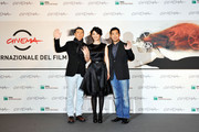 "Director Feng Xiaogang and actors Xu Fan and Zhang Guo Li attend the ""Back To 1942"" Photocall during the 7th Rome Film Festival at the Auditorium Parco Della Musica on November 11, 2012 in Rome, Italy."