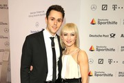 Aljona Savchenko and her partner Liam Cross attend Ball des Sports 2019 Gala at RheinMain CongressCenter on February 02, 2019 in Wiesbaden, Germany.
