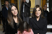 Julia Restoin Roitfeld and Carine Roitfeld attend the Balmain show as part of the Paris Fashion Week Womenswear Fall/Winter 2018/2019 on March 2, 2018 in Paris, France.