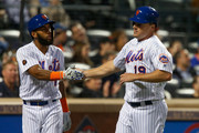 Jay Bruce #19 of the New York Mets celebrates after scoring in the fifth inning against the Baltimore Orioles with teammate Amed Rosario #1 at Citi Field on June 5, 2018 in the Flushing neighborhood of the Queens borough of New York City.