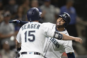 Nelson Cruz #23 of the Seattle Mariners gets a hug from Kyle Seager #15 of the Seattle Mariners after hitting a solo home run off of starting pitcher Andrew Cashner #54 of the Baltimore Orioles during the fifth inning of a game at Safeco Field on September 5, 2018 in Seattle, Washington.