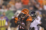 A.J. Green #18 of the Cincinnati Bengals runs the football upfield against Brandon Carr #24 of the Baltimore Ravens during their game at Paul Brown Stadium on September 13, 2018 in Cincinnati, Ohio. The Bengals defeated the Ravens 34-23.