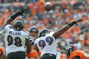 Nose tackle Brandon Williams #98 and defensive end Chris Canty #99 of the Baltimore Ravens attempt to block a pass by quarterback Peyton Manning #18 of the Denver Broncos in the first quarter of a game at Sports Authority Field at Mile High on September 13, 2015 in Denver, Colorado.