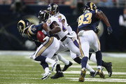 Matt Elam #26 of the Baltimore Ravens causes Tavon Austin #11 of the St. Louis Rams to fumble the ball during a pre-season game at the Edward Jones Dome on August 29, 2013 in St. Louis, Missouri.  The Rams beat the Ravens 24-21.