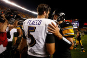 Joe Flacco #5 of the Baltimore Ravens shakes hands with Ben Roethlisberger #7 of the Pittsburgh Steelers after a 26-14 win over the Pittsburgh Steelers at Heinz Field on September 30, 2018 in Pittsburgh, Pennsylvania.
