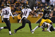 Antonio Brown #84 of the Pittsburgh Steelers runs upfield after a catch as Anthony Levine #41 of the Baltimore Ravens defends in the second half during the game at Heinz Field on September 30, 2018 in Pittsburgh, Pennsylvania.