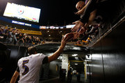 Joe Flacco #5 of the Baltimore Ravens hands a ball to a fan as he leaves the field after a 26-14 win over the Pittsburgh Steelers at Heinz Field on September 30, 2018 in Pittsburgh, Pennsylvania.