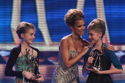 Sylvie van der Vaart congratulates the twins Sophia and Jana Muenster during the Bambi 2010 Award Ceremony at Filmpark Babelsberg on November 11, 2010 in Potsdam, Germany.