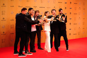 (L-R) Hartmunt Engler, Andreas Bourani, Christina Stuermer, Tobias Kuenzel, Yvonne Catterfeld, Sebastian Krumbiegel and Daniel Wirtz are seen with their awards at the Bambi Awards 2015 winners board at Stage Theater on November 12, 2015 in Berlin, Germany.