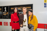Nico Rosberg (C), Rebecca Mir (L) and Annemarie Carpendale pose with a Bambi trophy before they travel with the trophies to the Bambi Awards in Berlin by train at Munich Central Station on November 15, 2018 in Munich, Germany. The 70th Bambi Awards will take place on November 16, 2018 in Berlin.