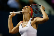 Sabine Lisicki of Germany reacts after missing a shot against Kimiko Date-Krumm of Japan during day two of the Bank of the West Classic at the Stanford University Taube Family Tennis Stadium on August 4, 2015 in Stanford, California.