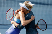 Mona Barthel of Germany and Sabine Lisicki of Germany celebrate their doubles win against Raquel Kops-Jones and Maria Sanchez of the United States during day three of the Bank of the West Classic at the Stanford University Taube Family Tennis Stadium on August 5, 2015 in Stanford, California.